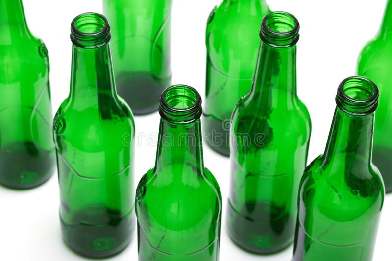 Empty green glass bottles isolated on white background. Concept for recycling.  stock image
