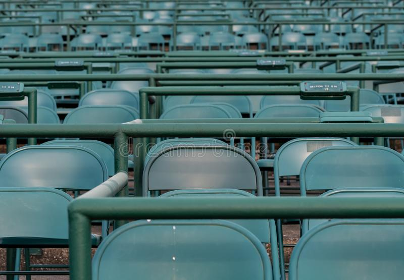 Empty Green Stadium Chairs at Horse Track royalty free stock photography