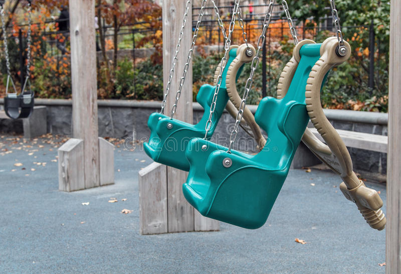 Empty green swings royalty free stock images