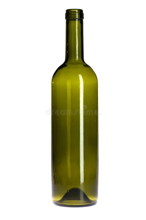 Empty green wine bottle on white royalty free stock image
