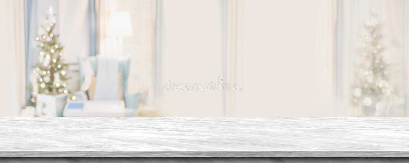 Empty grey marble table top with abstract warm living room decor royalty free stock image