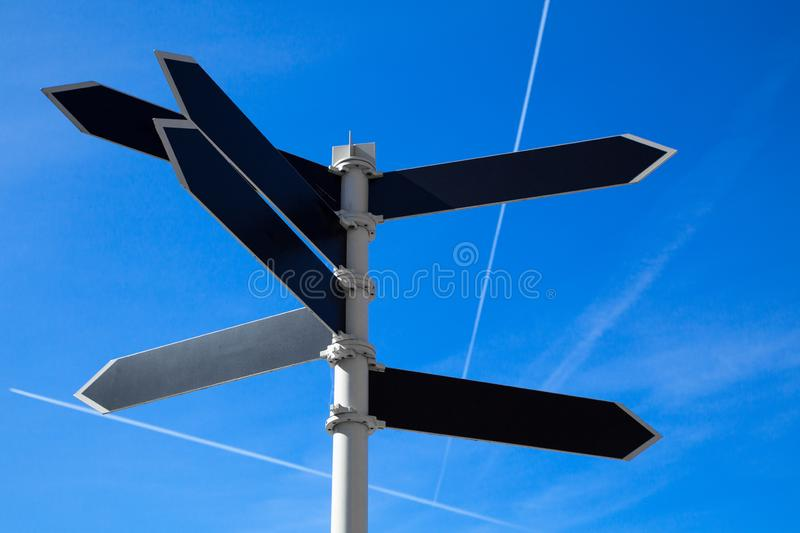 Empty guidepost with arrow shaped labels stock photo