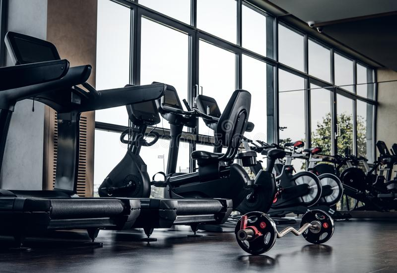 Empty gym club with different type of training apparatuses royalty free stock photos