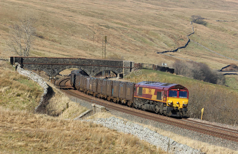 Empty Gypsum train at Ais Gill, Mallerstang. Freight train of empty gypsum containers on the Settle to Carlisle railway line near Ais Gill summit at the top of royalty free stock photo