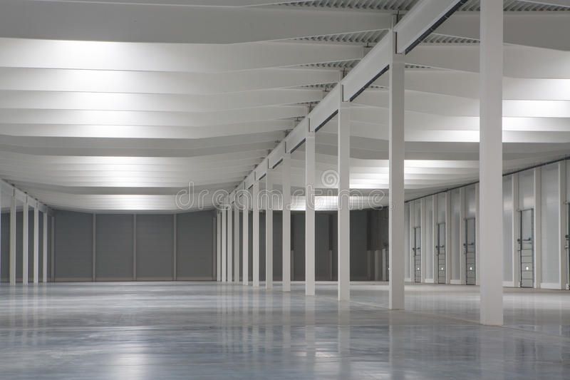 Empty hall. White painted empty logistic hall stock image