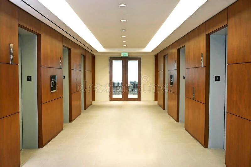 Empty hallway between elevators stock photos
