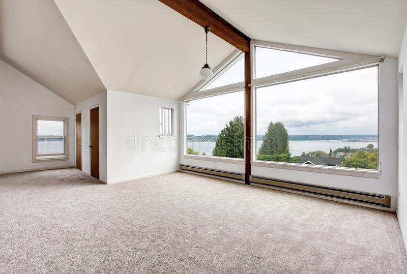 Empty hallway interior with carpet floor, big window and perfect water view stock photography