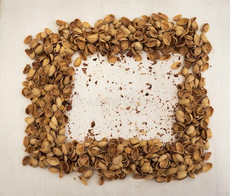 Empty halves of pistachio shells stock photo