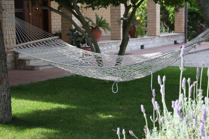 Empty hammock in the garden royalty free stock photography