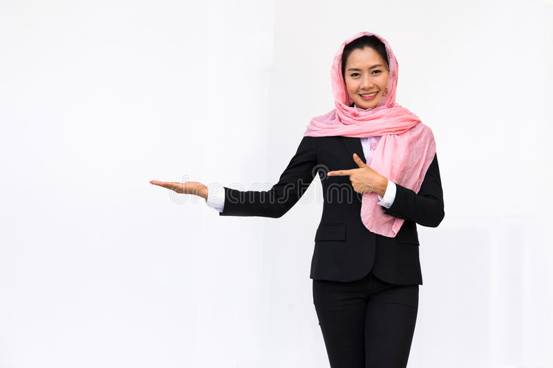 Empty hand holding of businesswoman in suit wearing pink turban stock photos