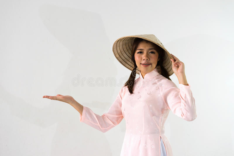 Empty hand holding of smiling woman in beautiful pink dress stock photos