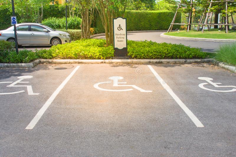 Empty handicap parking areas in parking lot reserved for disabled people at outdoor. stock photo