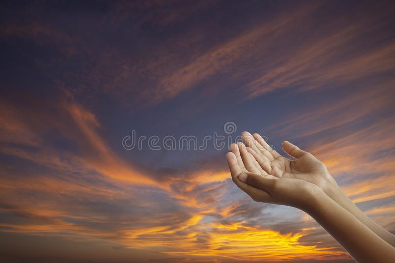 Empty hands Muslims are praying during the ramadan months,concept: to worship the God of heaven for mercy,Friday prayer times stock photo