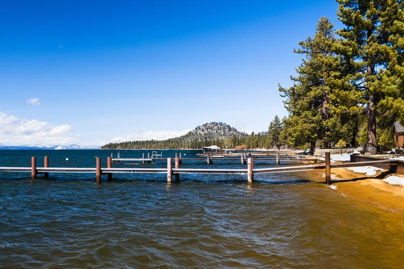 Empty harbor piers on a sunny winter day in south Lake Tahoe, Sierra Mountains, California stock photo
