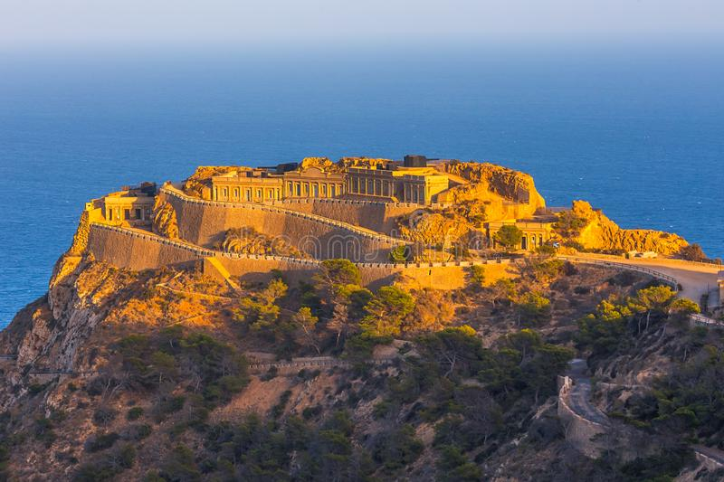 Empty heritage unusual famous place Castillitos Battery, ancient landmark on coast of Mediterranean Sea, fortification. Fortified wall of Cartagena city royalty free stock image