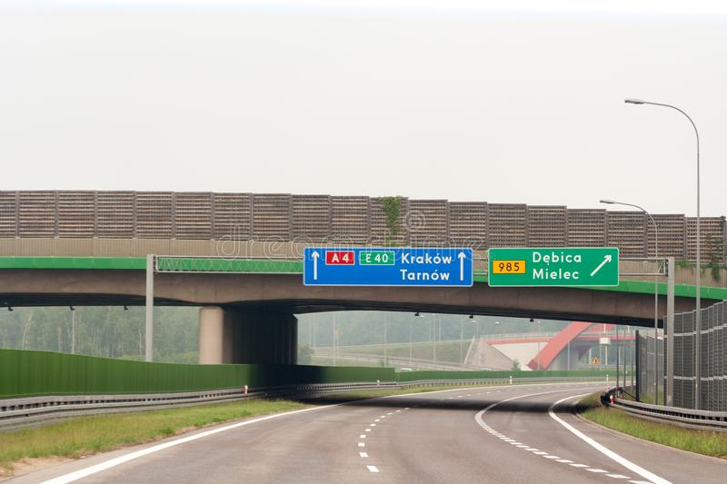 Empty highway, bridge and road signs with City name. S: Krakow, Tarnow, Debica, Mielec. 26 May, 2018 - A4 highway, Poland stock photography