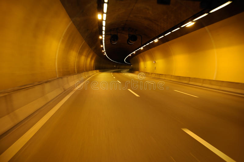 Empty highway road at night tunnel stock images
