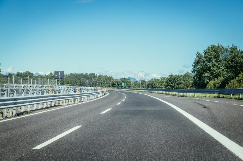 Empty highway on a sunny summer day. Highway travel holiday transport mobility road empty summer tour season blue sky traffic infrastructure nobody motorway stock photos