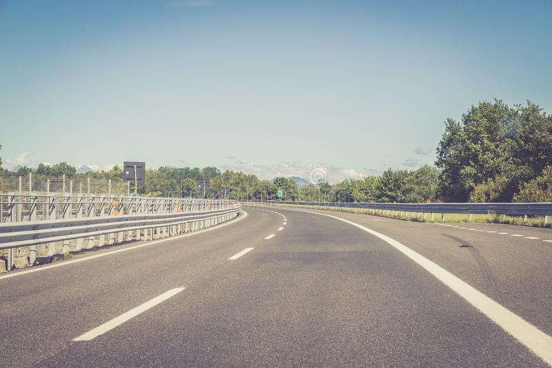 Empty highway on a sunny summer day. Highway travel holiday transport mobility road empty summer tour season blue sky traffic infrastructure nobody motorway royalty free stock photos