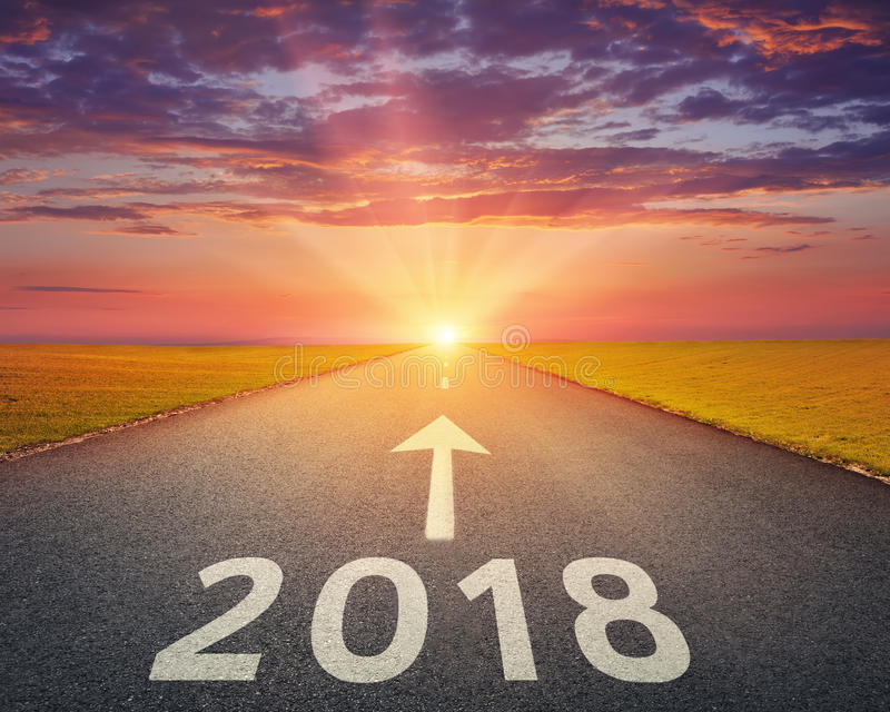 Empty highway to upcoming 2018 at sunset stock image