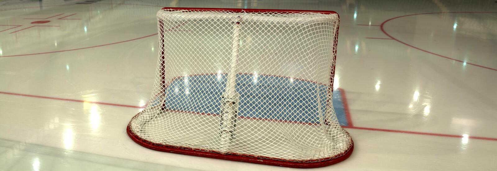 Empty hockey goal on ice rink. Side view stock images