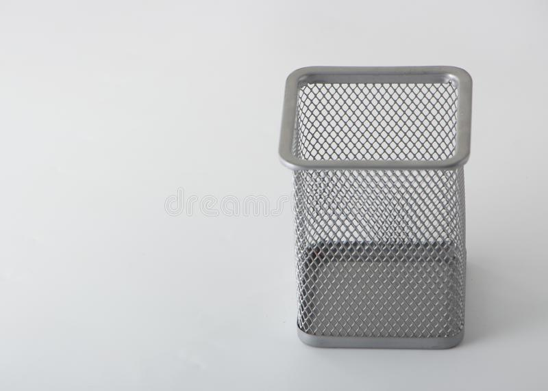 Empty holder cup for pens on white background. Close up stock photo