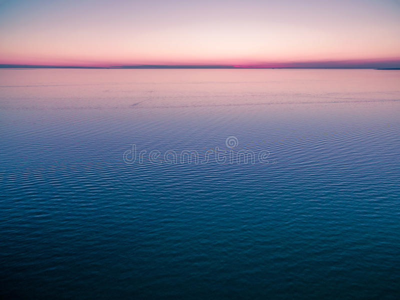 Empty horizon over water at dusk. nothing but water and clear sk stock photos