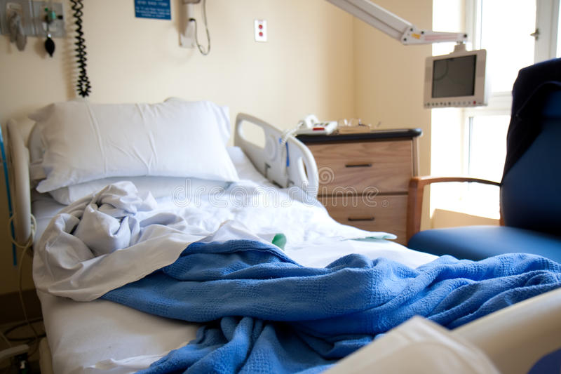 Empty hospital bed stock photography