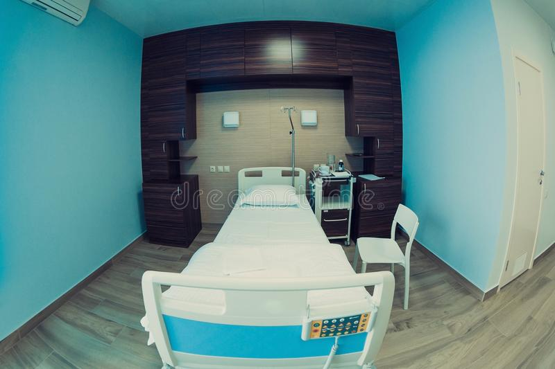 Empty hospital room for one client. stock photography