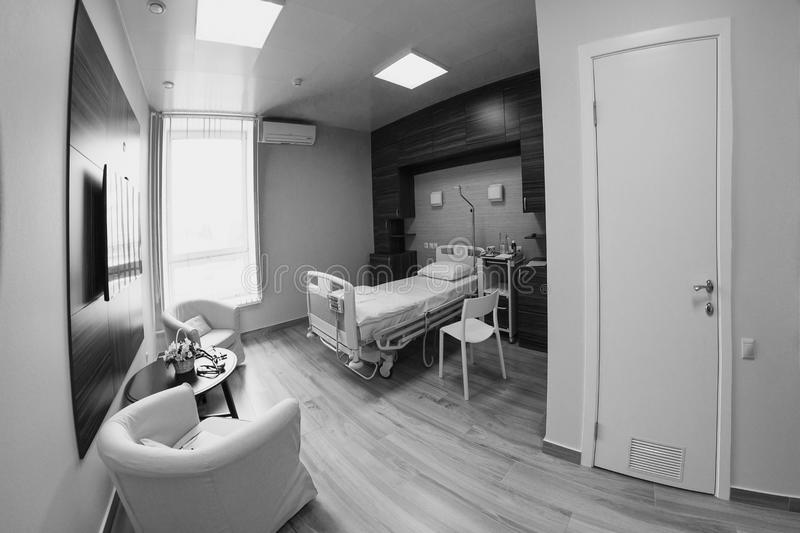 Empty hospital room for one client. stock photo