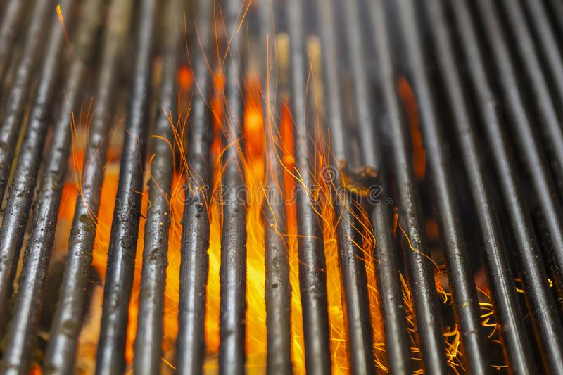 Hot Charcoal Barbecue Grill With Bright Flame. Empty Hot Charcoal Barbecue Grill With Bright Flame stock photos