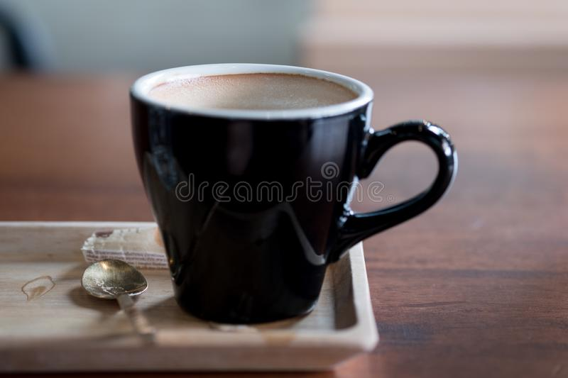 Empty hot coffee cup after drink. On wooden tray royalty free stock images