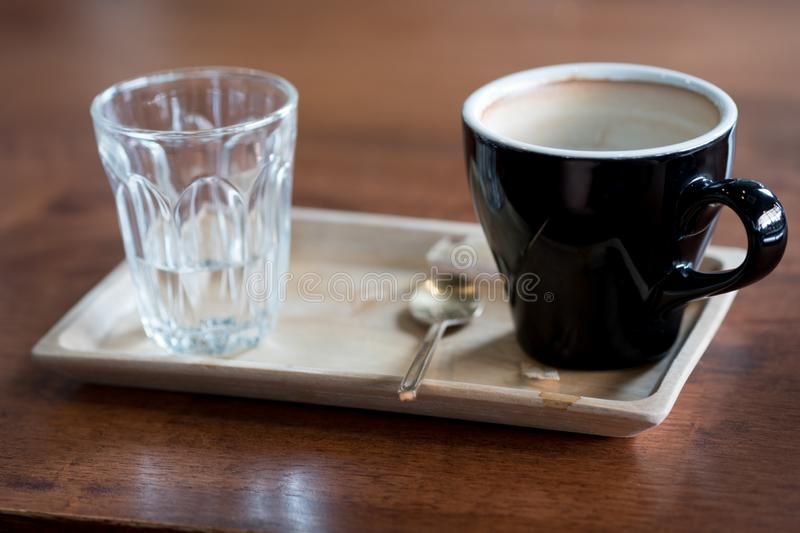 Empty hot coffee cup after drink. On wooden tray royalty free stock photography
