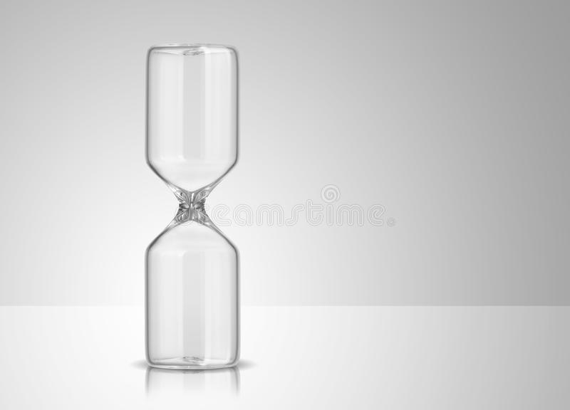 Empty hourglass. On gray background stock image