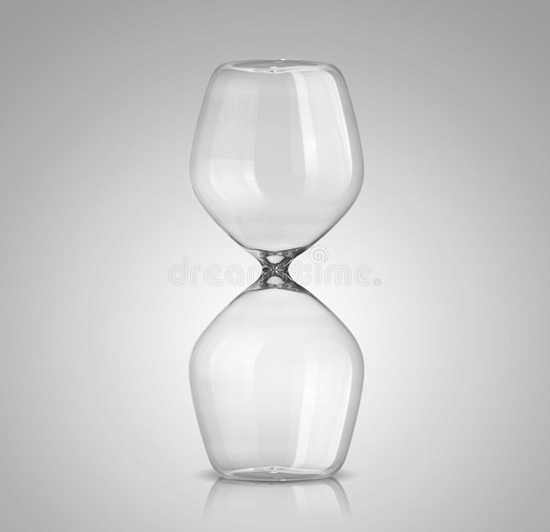 Empty hourglass. On gray background royalty free stock photos
