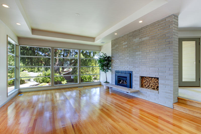 Empty house interior. Living room with glass wall and brick wall stock photo