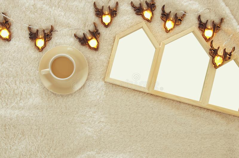Empty houses shape wooden photo frames over cozy and warm fur carpet. For photography montage. Scandinavian style design. Top view stock images