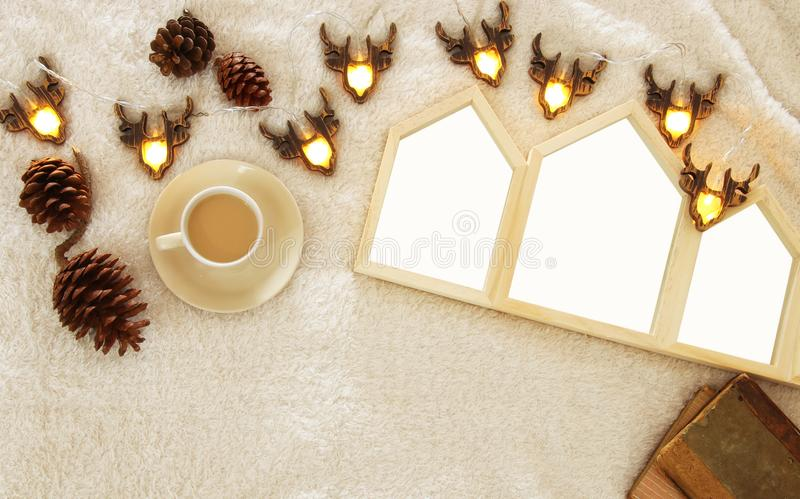 Empty houses shape wooden photo frames over cozy and warm fur carpet. For photography montage. Scandinavian style design. Top view royalty free stock images
