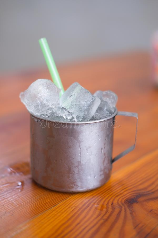 Empty ice in aluminium mug for drink in Thai restaurant. Popular for street food in Thailand royalty free stock photo
