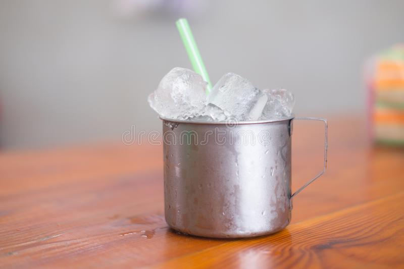 Empty ice in aluminium mug for drink in Thai restaurant. Popular for street food in Thailand stock photos