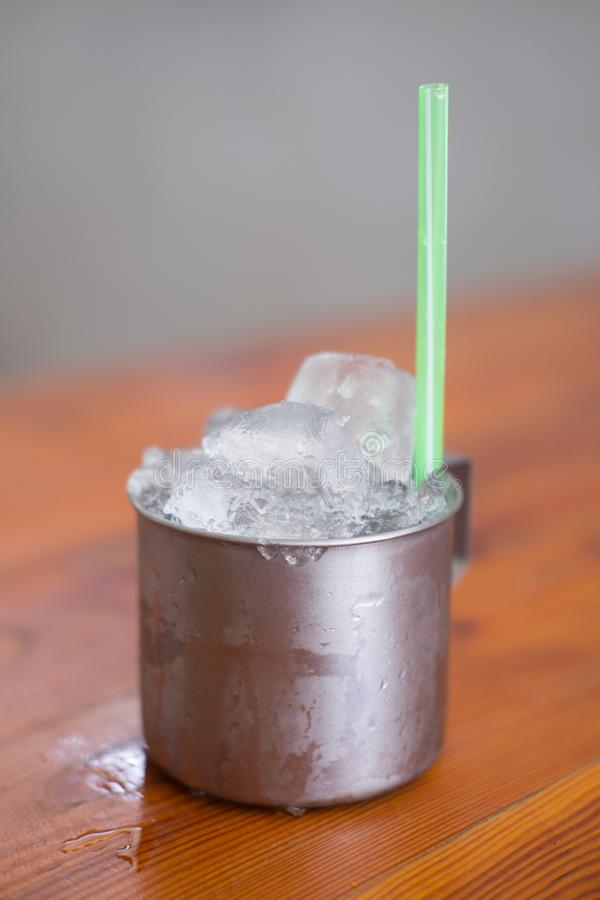 Empty ice in aluminium mug for drink in Thai restaurant. Popular for street food in Thailand royalty free stock photography
