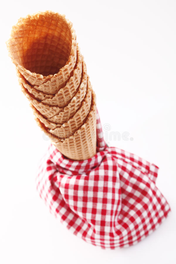 Empty ice-cream cones with checkered napkin royalty free stock photo