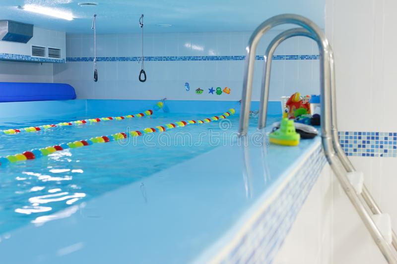 Empty indoors public swimming pool. sports rings. children center, pool stock images