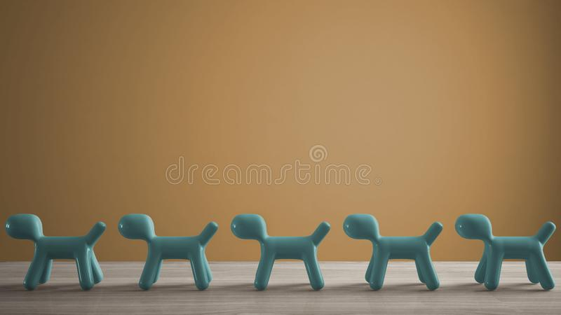 Empty interior design concept, wooden table or shelf with line of blue stylized dogs, dog friendly concept, love for animals,. Animal dog proof home, yellow stock photo