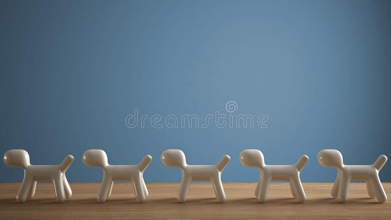 Empty interior design concept, wooden table or shelf with line of five stylized dogs, dog friendly concept, love for animals,. Animal dog proof home, blue color royalty free stock photo