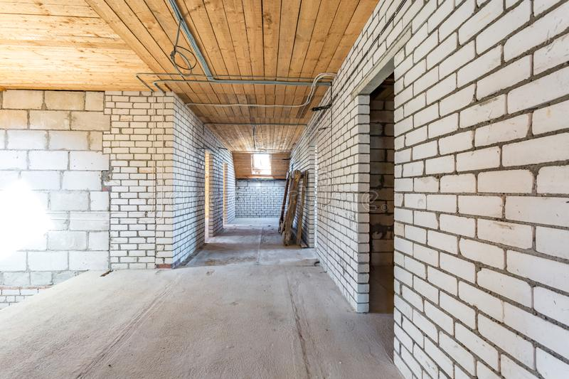 Empty interior in house without repair with white silicate brick walls.  royalty free stock image