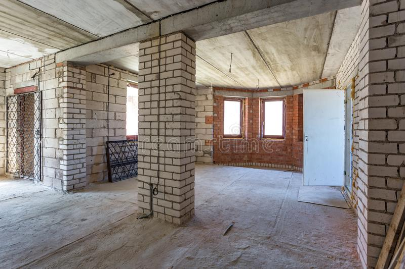 Empty interior in house without repair with white silicate brick walls.  stock image