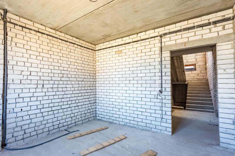 Empty interior in house without repair with white silicate brick walls.  stock photography