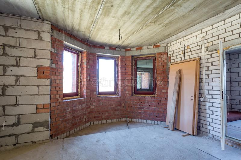 Empty interior in house without repair with white silicate brick walls.  royalty free stock photo