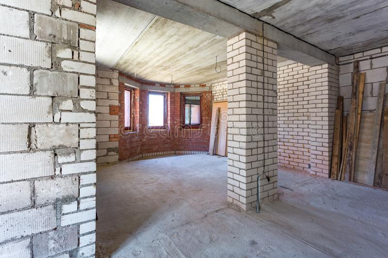 Empty interior in house without repair with white silicate brick walls.  royalty free stock photography